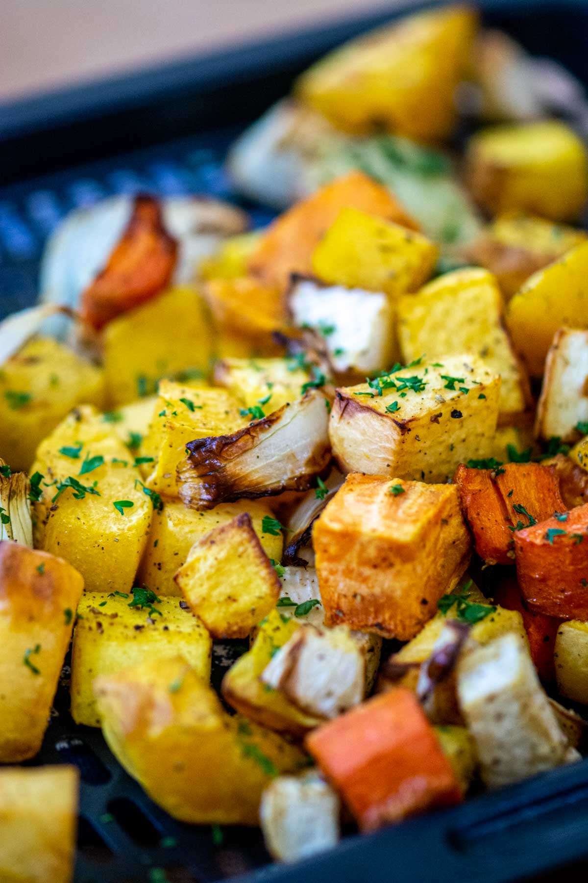 tray of air fryer roasted root vegetables with Parsley.