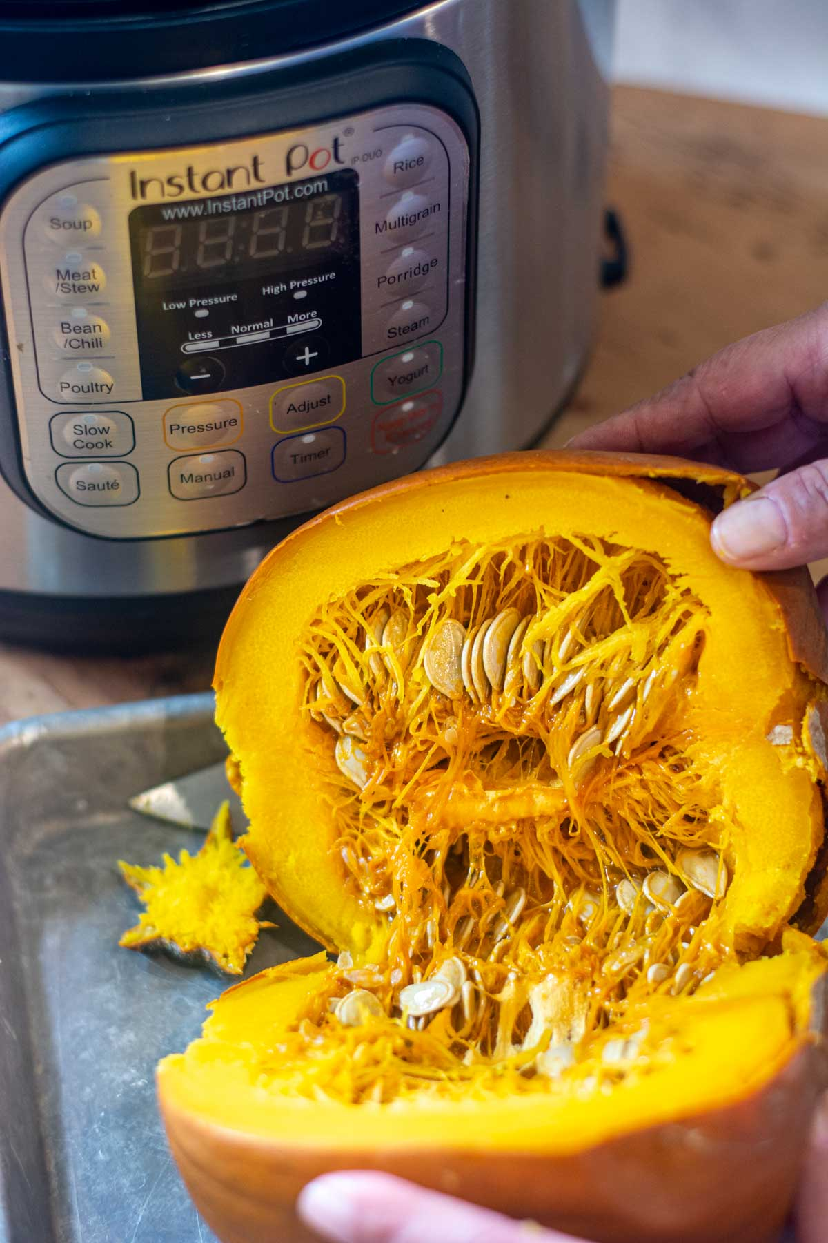 pumpkin cut in half after being in the Instant Pot.