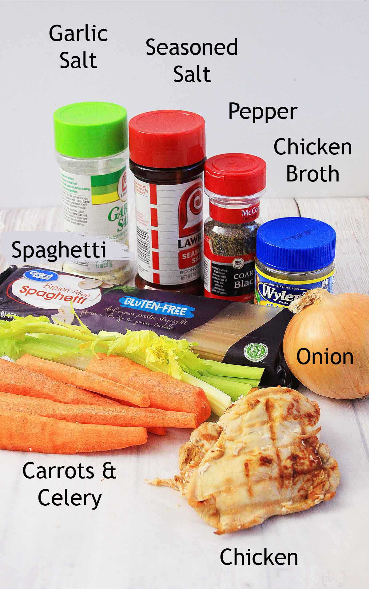 all of the ingredients for the soup sitting on the table with labels.