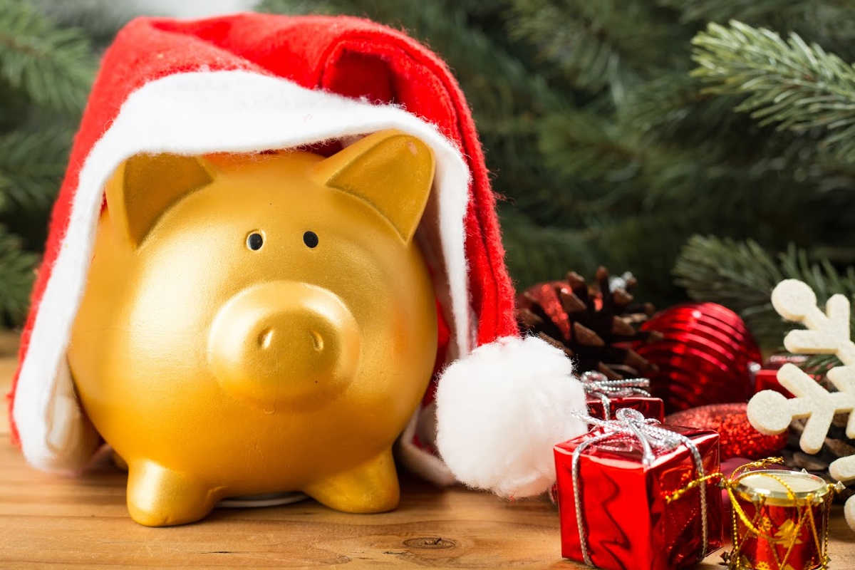 gold piggy bank with a Santa Hat