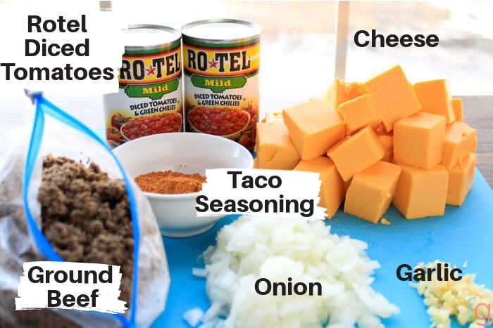 ingredients for this Mexican Dip stacked on a counter with labels.