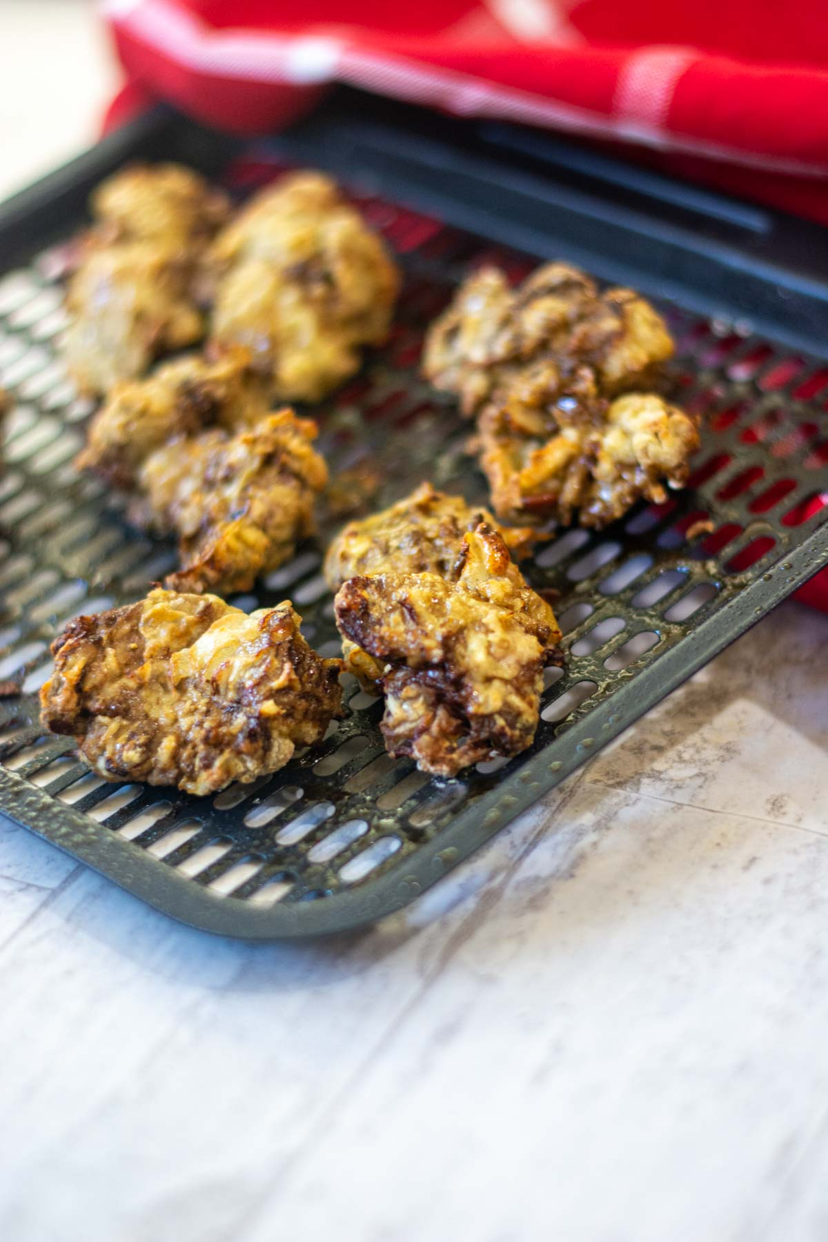 chicken livers on an air fryer tray that are perfectly cooked.