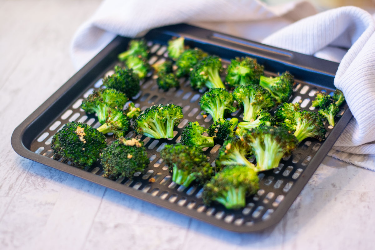 tray of broccoli after being removed from the air fryer.