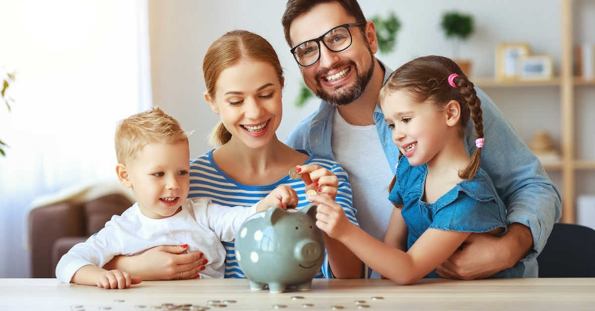 family working together to ad more money to the piggy bank.