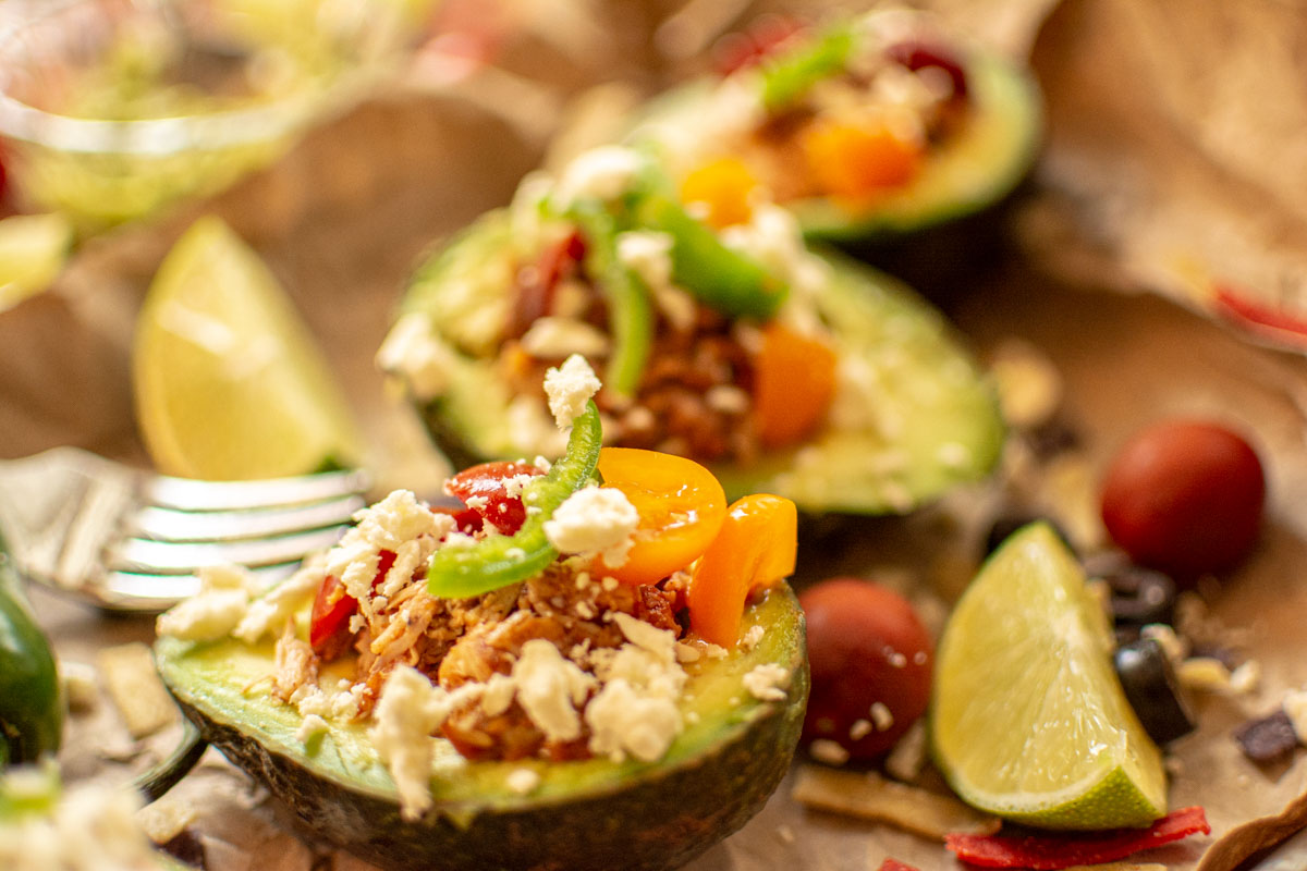 avocado stuffed with taco seasoning chicken, cheeses and tomatoes.