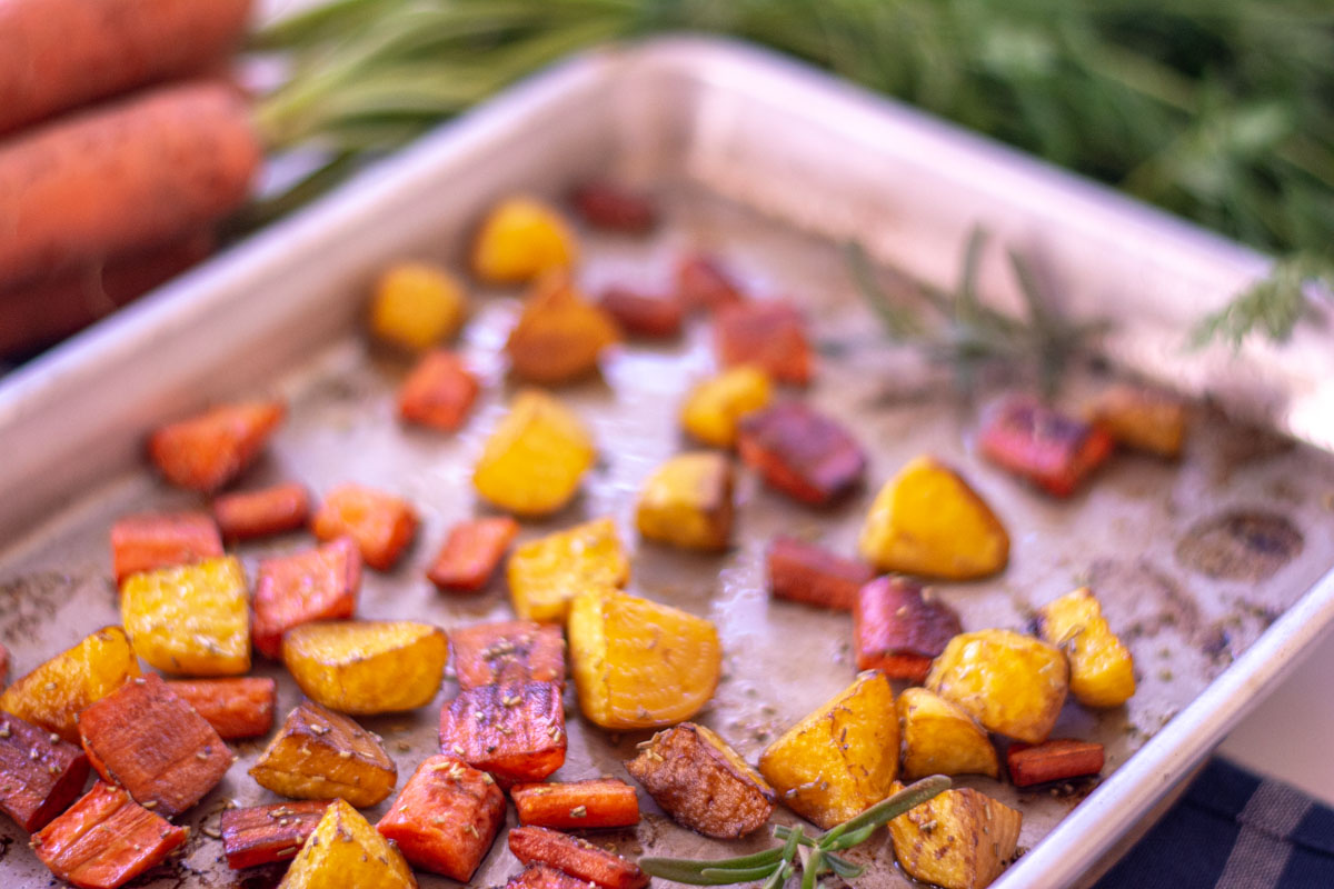 sprigs of rosemary on the roasted beets and carrots.