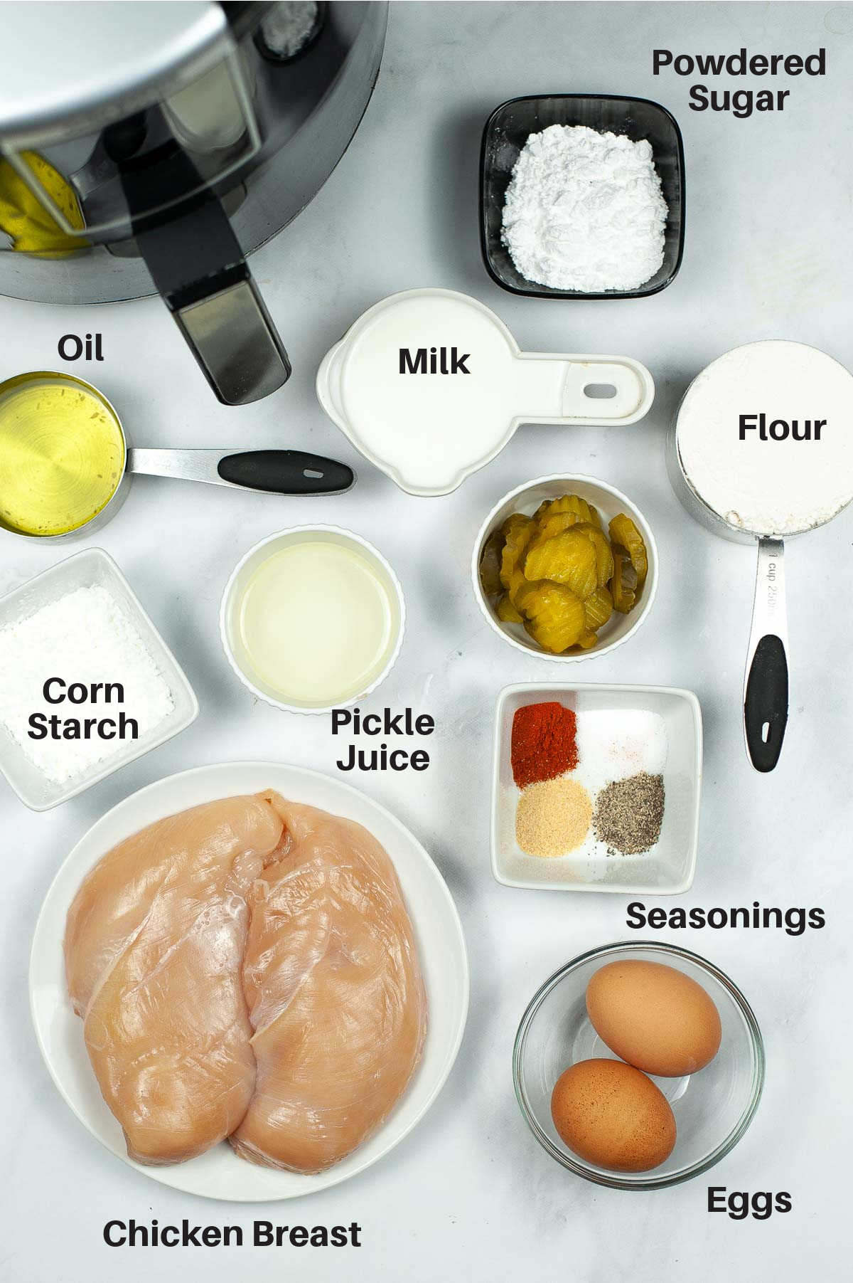 ingredient photo showing everything on a white counter with labels.