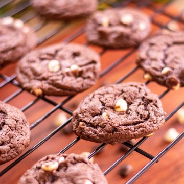 cake mix cookies on a cooling rack with white chocolate and espresso chips.