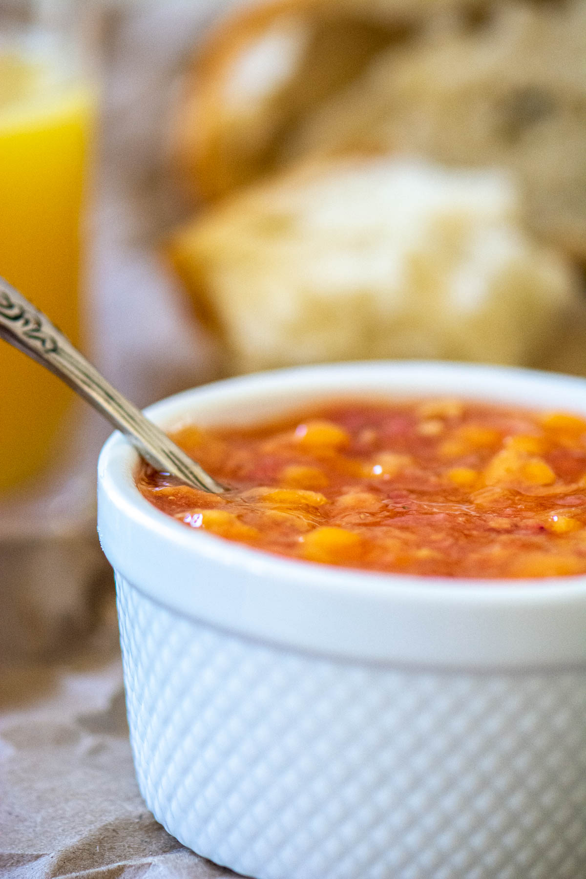 closeup of the freezer strawberry mango jam in a white dish.