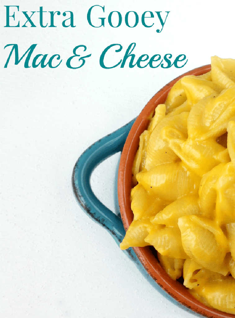 bowl of mac and cheese that is very gooey.