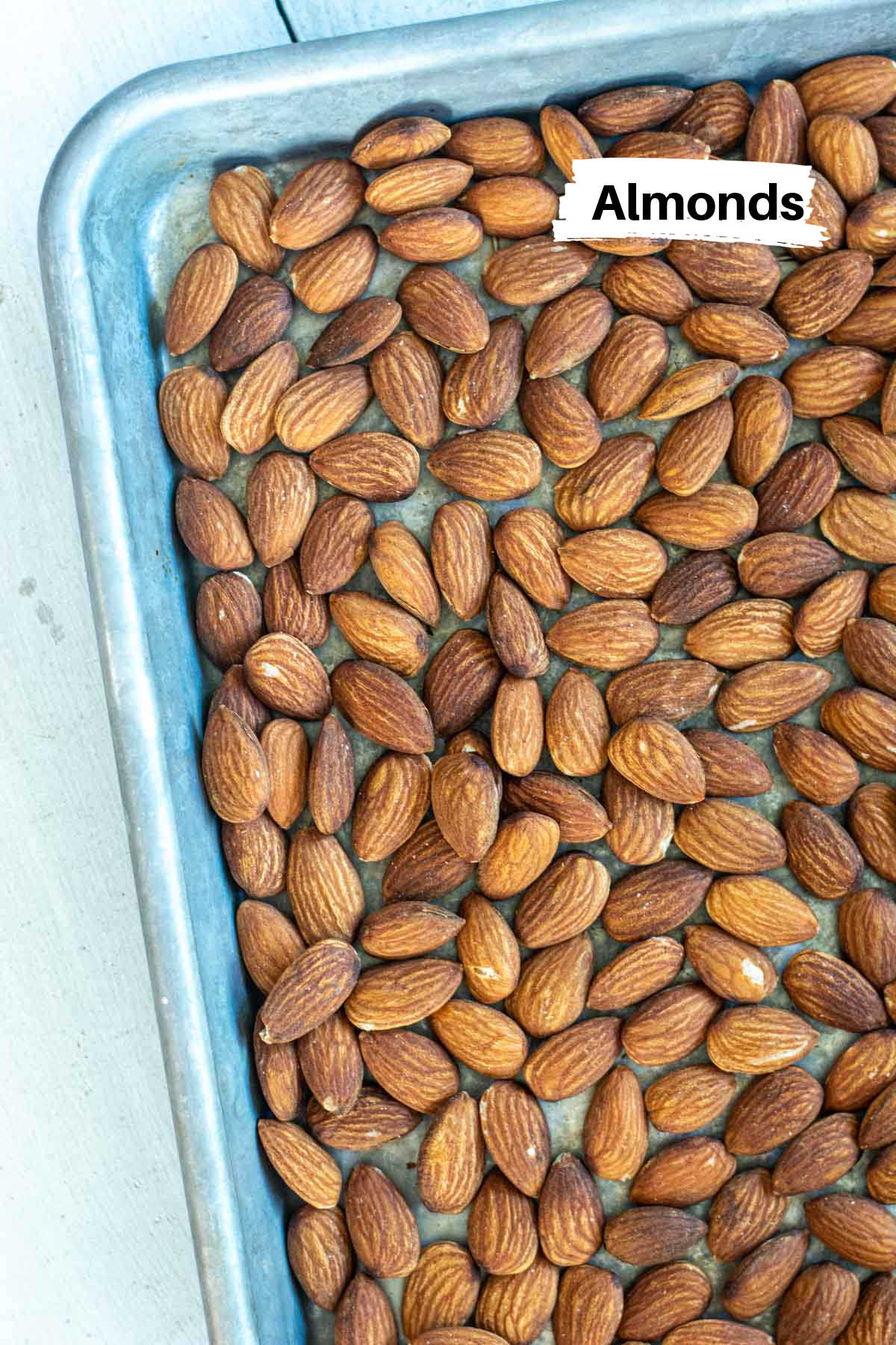 ingredient photo of just almonds on a sheet pan ready to be toasted.