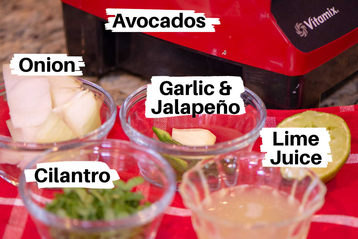 ingredients for homemade blender guacamole on a counter with labels.