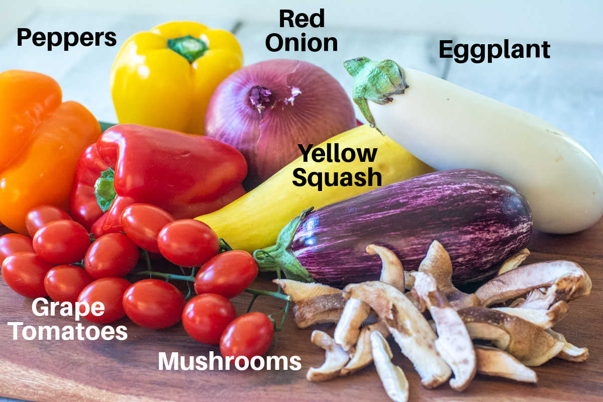 fresh vegetables are the ingredients on a counter with labels.