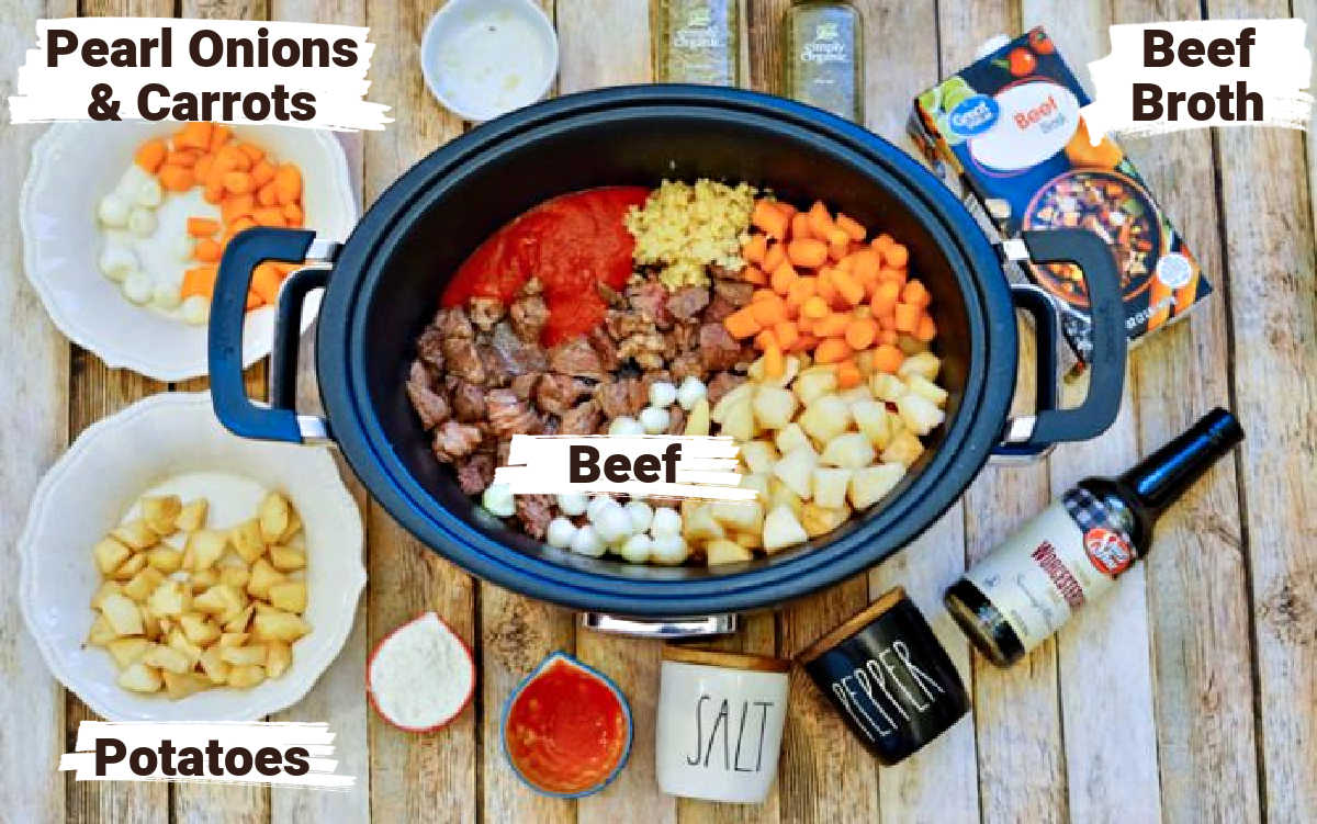 slow cooker filled with beef, potatoes, onions, carrots and other ingredients.