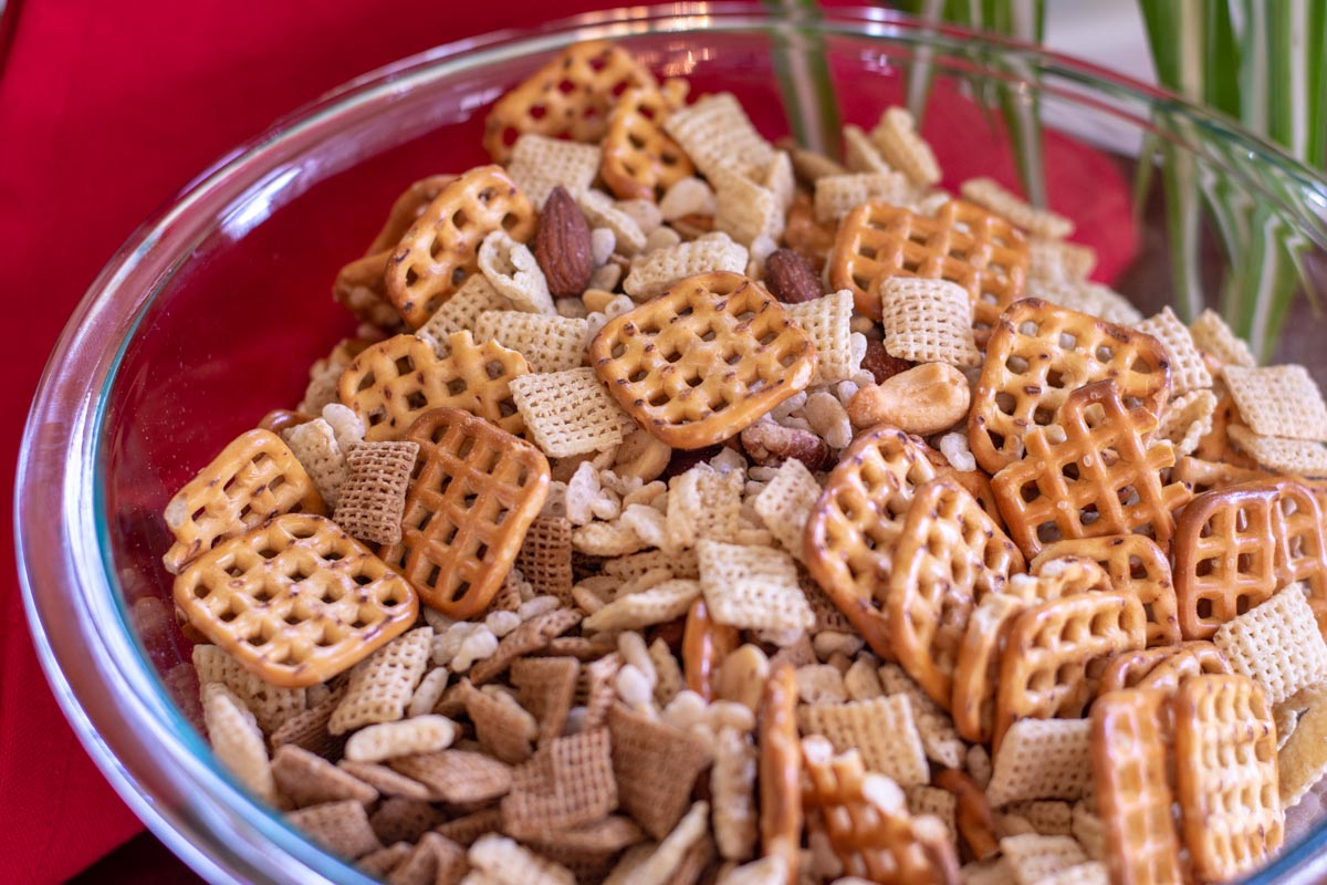 bowl of chex mix and nuts.
