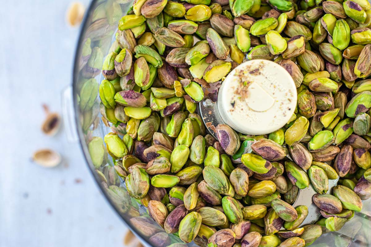 shelled pistachios in a food processor.