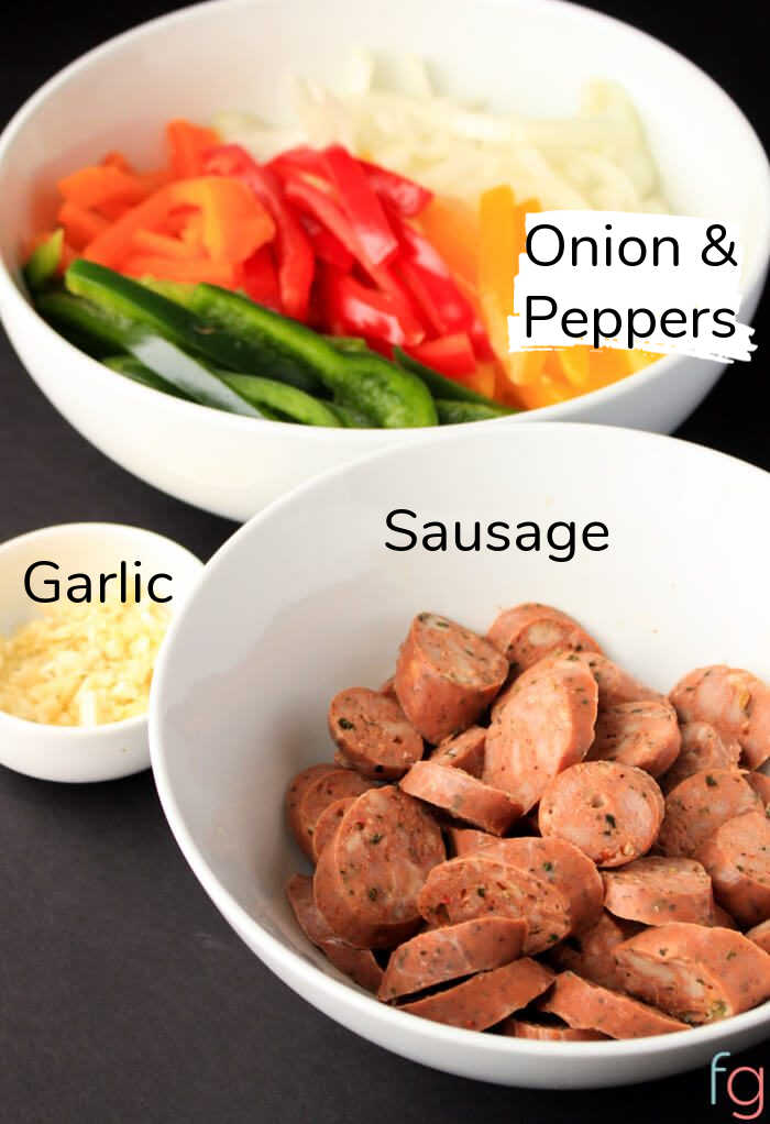 ingredient photo showing the major components including the sausage, garlic, peppers and onion.