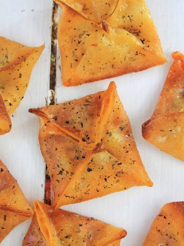 top down view of crispy wontons filled with pizza ingredients.