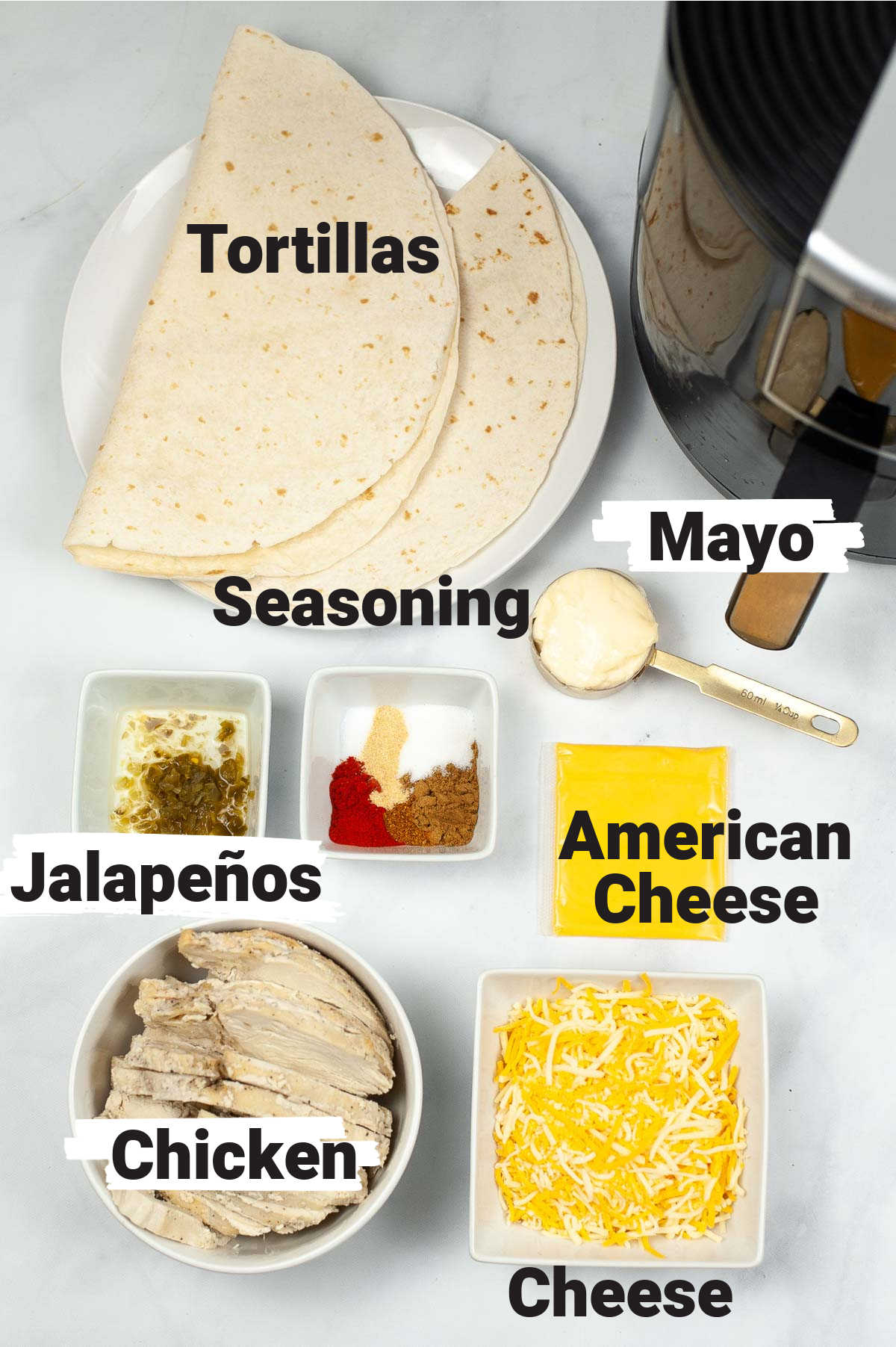 quesadilla ingredients on a white table with labels.