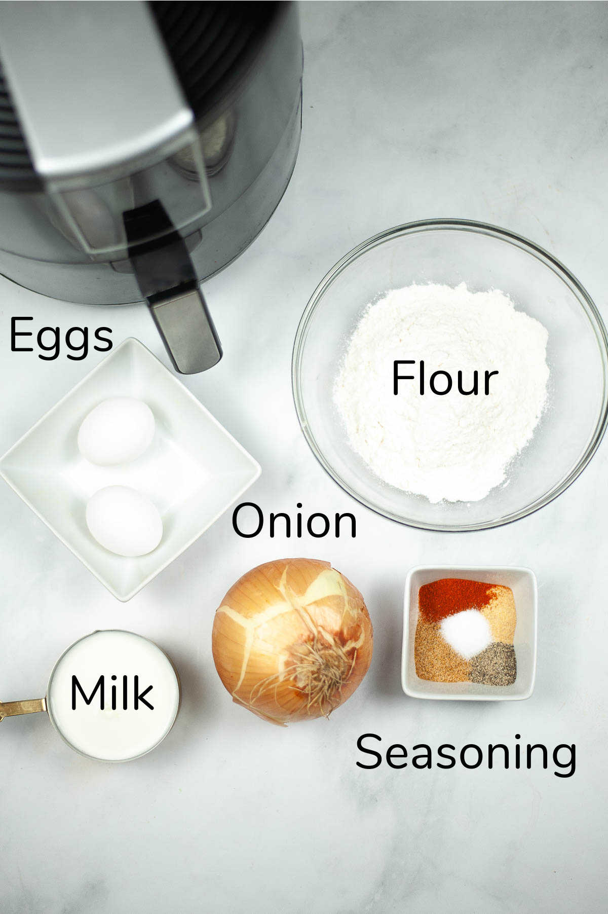ingredient photo showing the few items needed to make the blooming onion with labels.