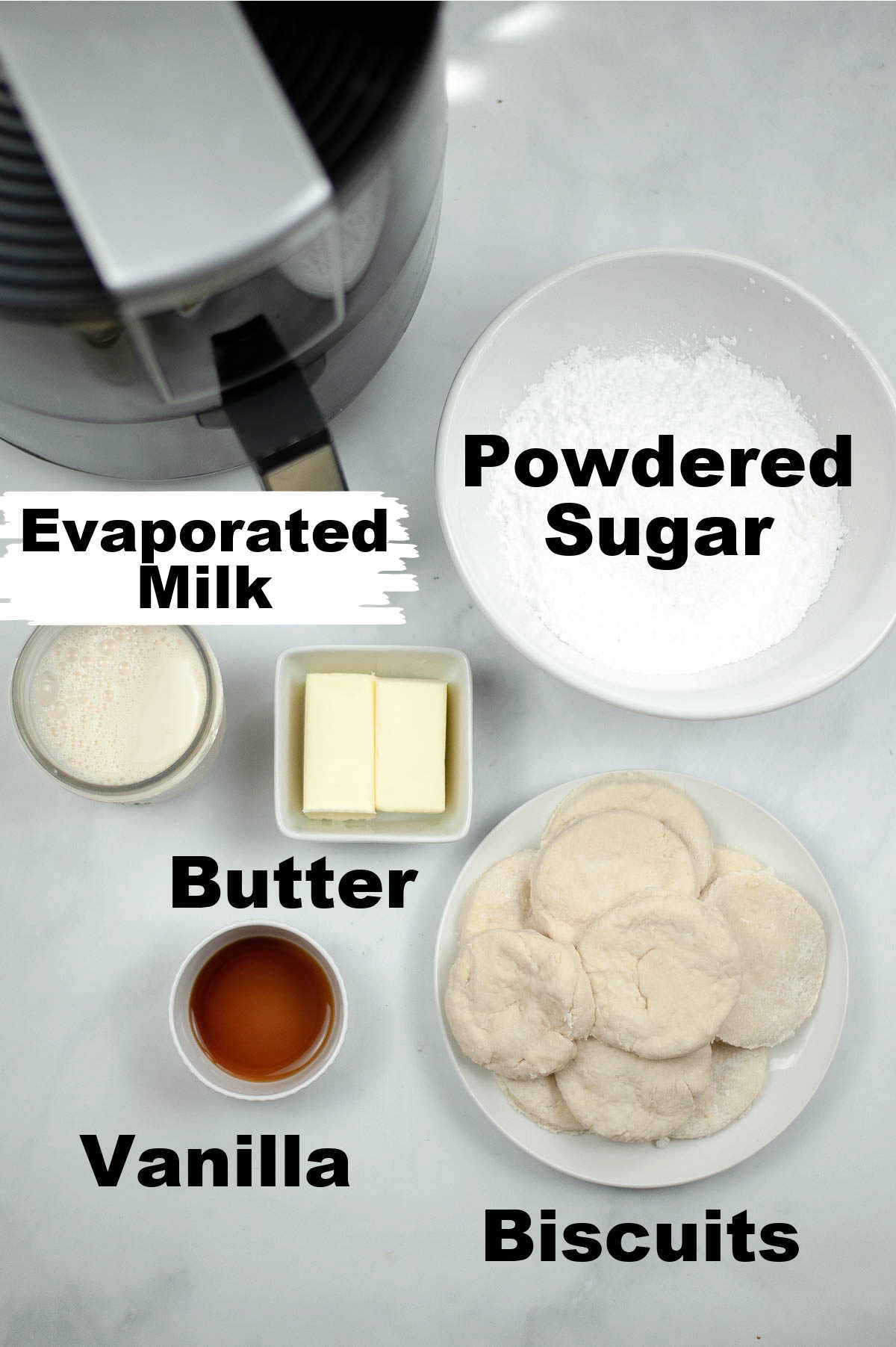 five ingredients laid out on a counter with labels.