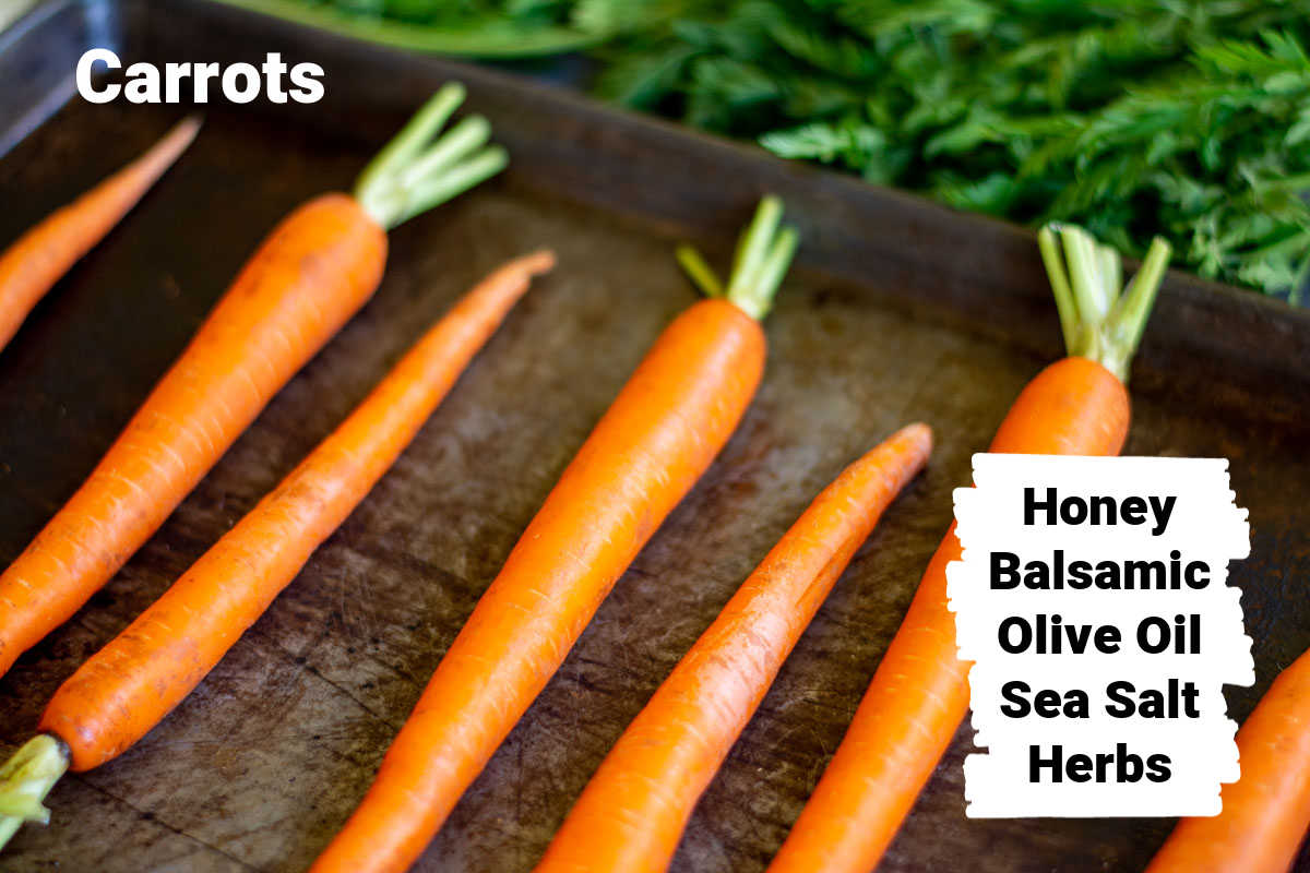 fresh carrots on a sheet pan and labels for all of the ingredients.