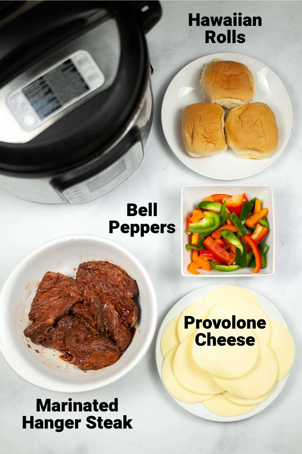 ingredient photo showing steak, cheese, peppers and rolls with labels.