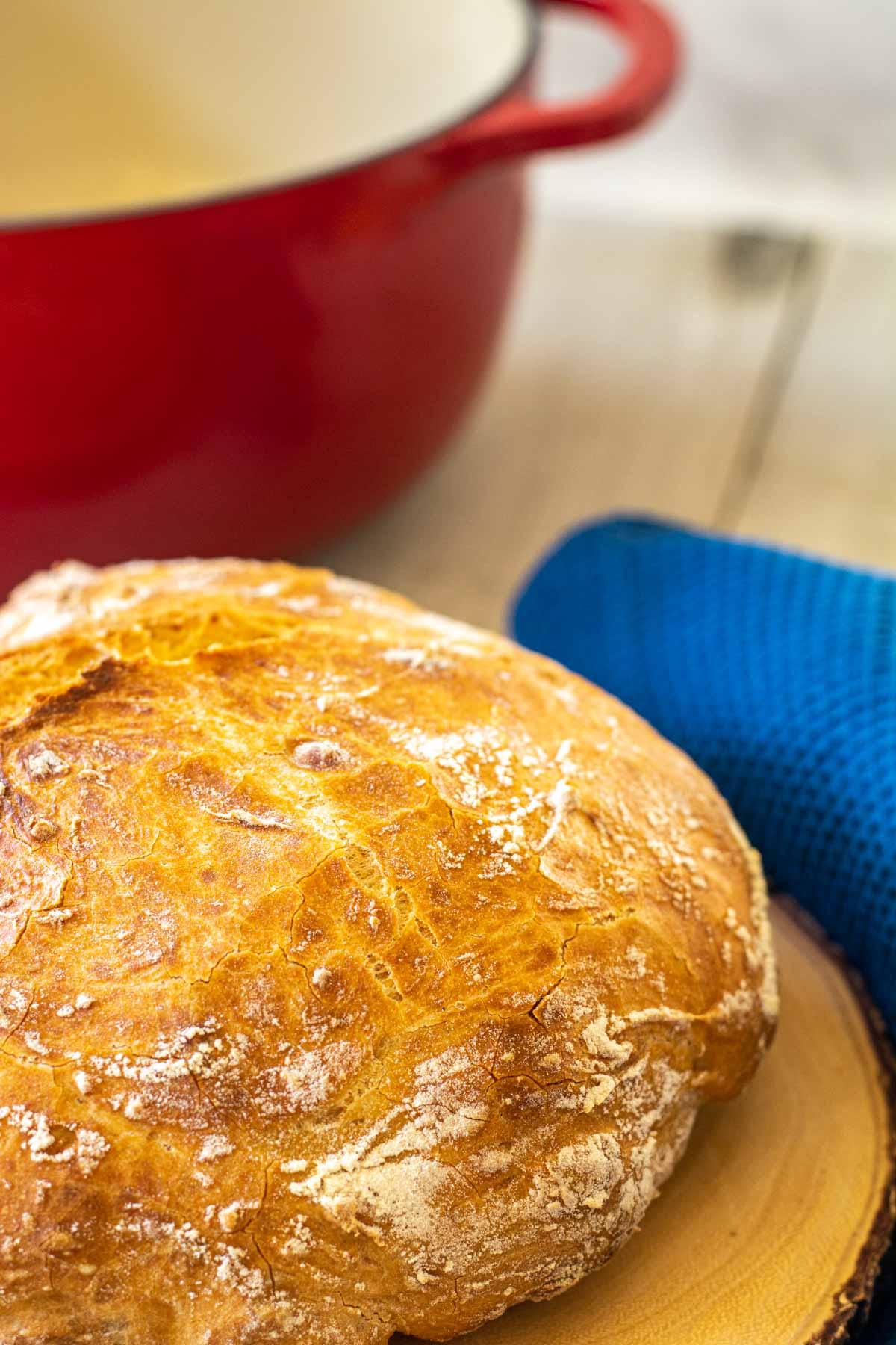 loaf of bread on a wooden trivet.