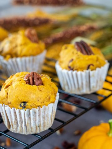 healthy pumpkin and yogurt muffin on a cooling rack.