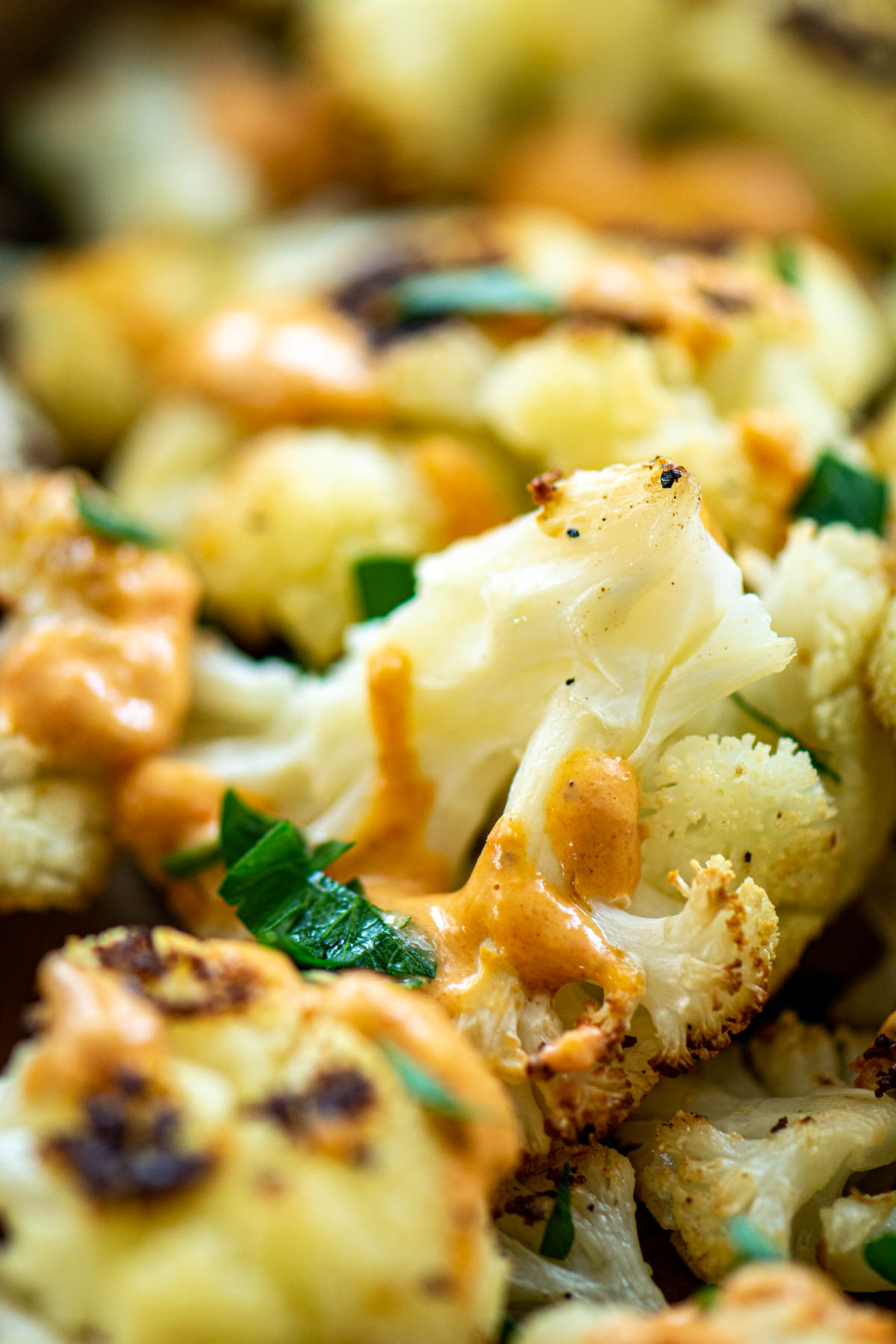 front view of roast cauliflower with tahini.