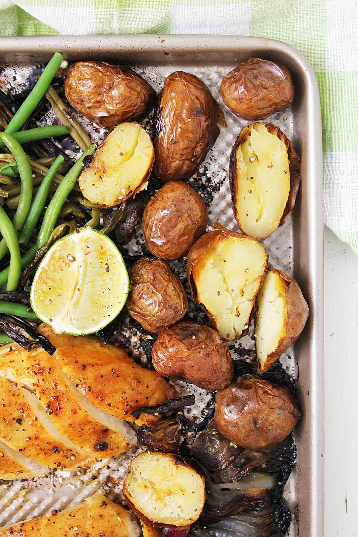 sheet pan with roasted potatoes and chicken.