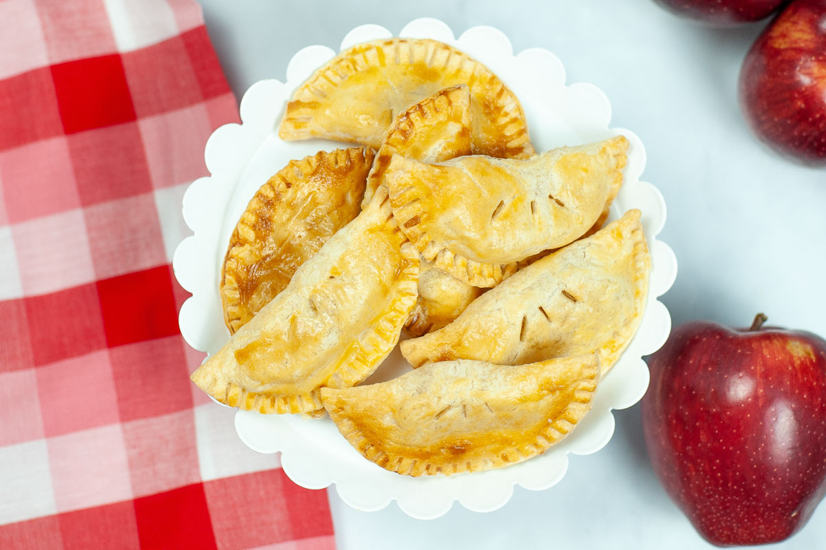 top down view of air fryer apple hand pies.