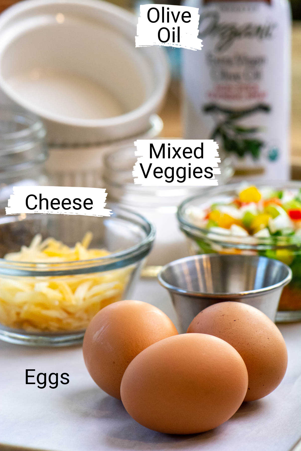 ingredient photo with eggs, cheese, and veggies with labels.
