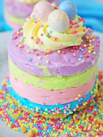 no bake cadbury cheesecake in bright spring colors on a white plate.