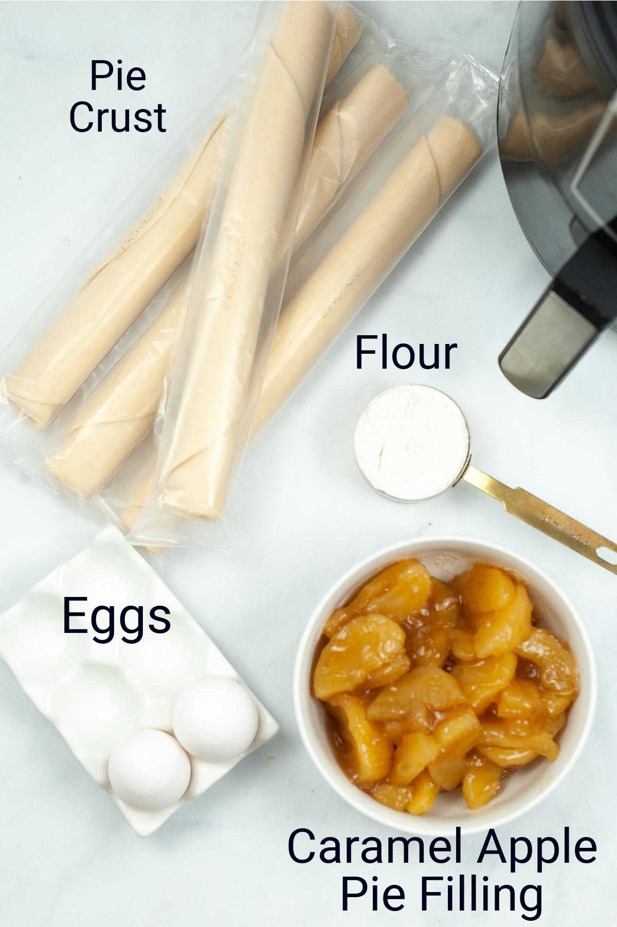 ingredient photo showing the pie crust, flour, eggs and pie filling on a counter with labels.