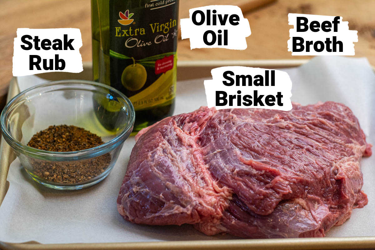 ingredient photo showing the rub, oil, beef broth and the brisket with labels.