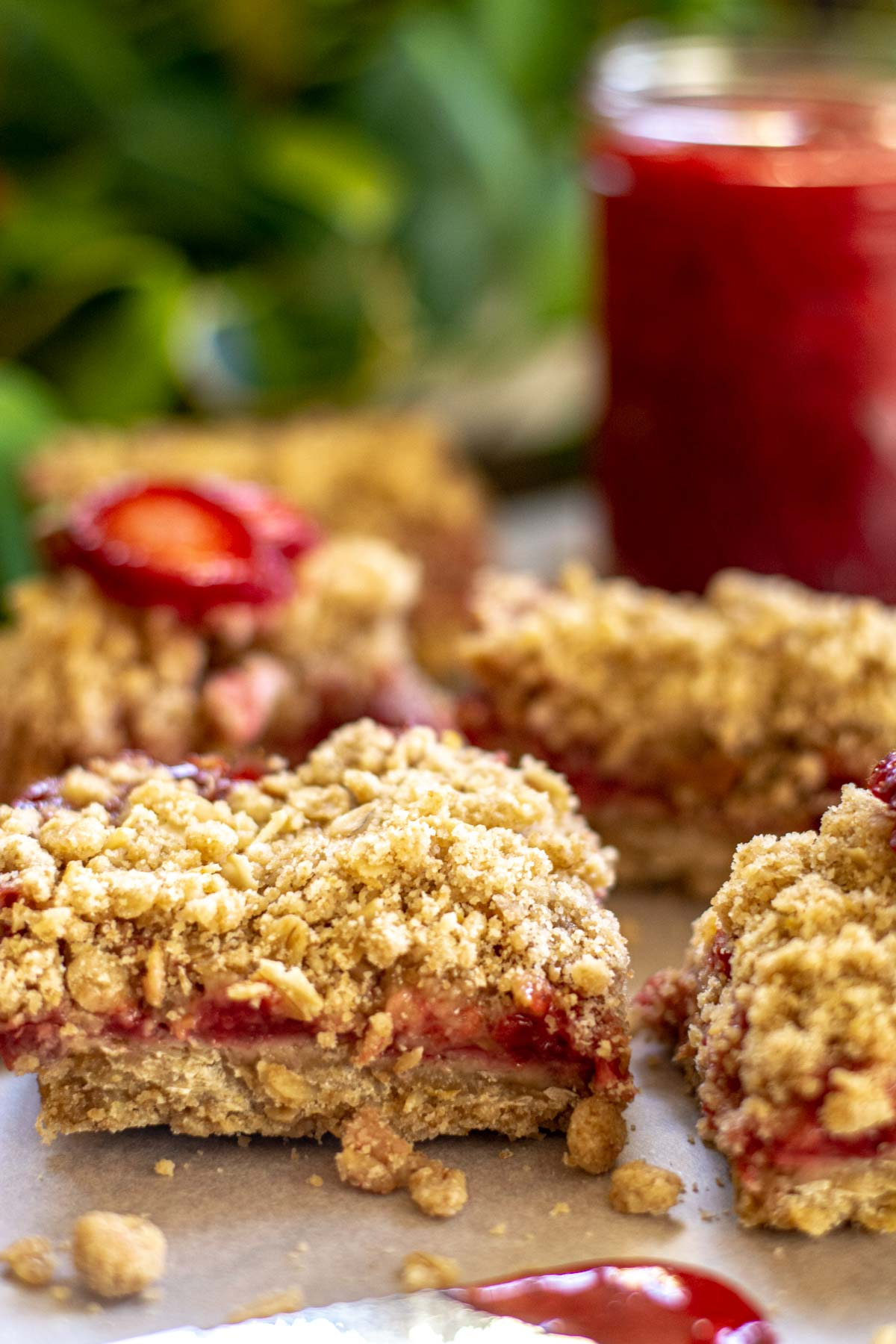 crumbly jam bars and jelly on the counter.