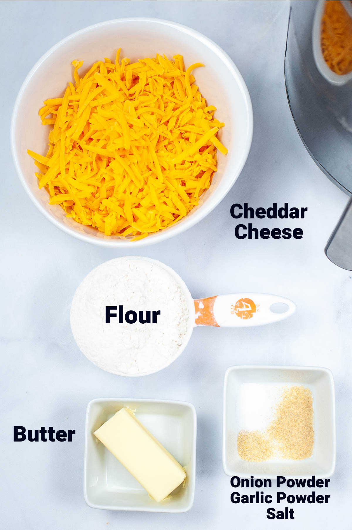 top down ingredient photo with cheese, flour, butter and seasonings with labels.