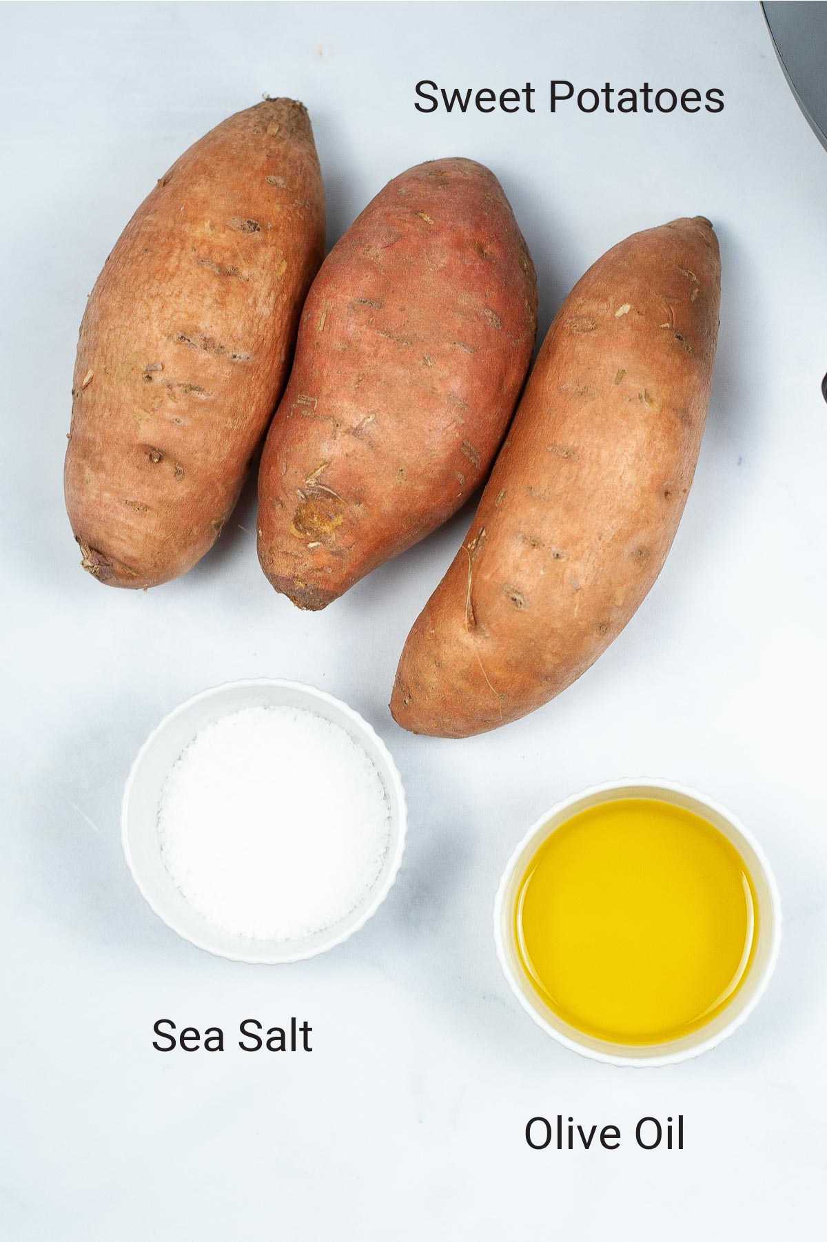 ingredient photo showing the sweet potatoes, salt and oil with labels.