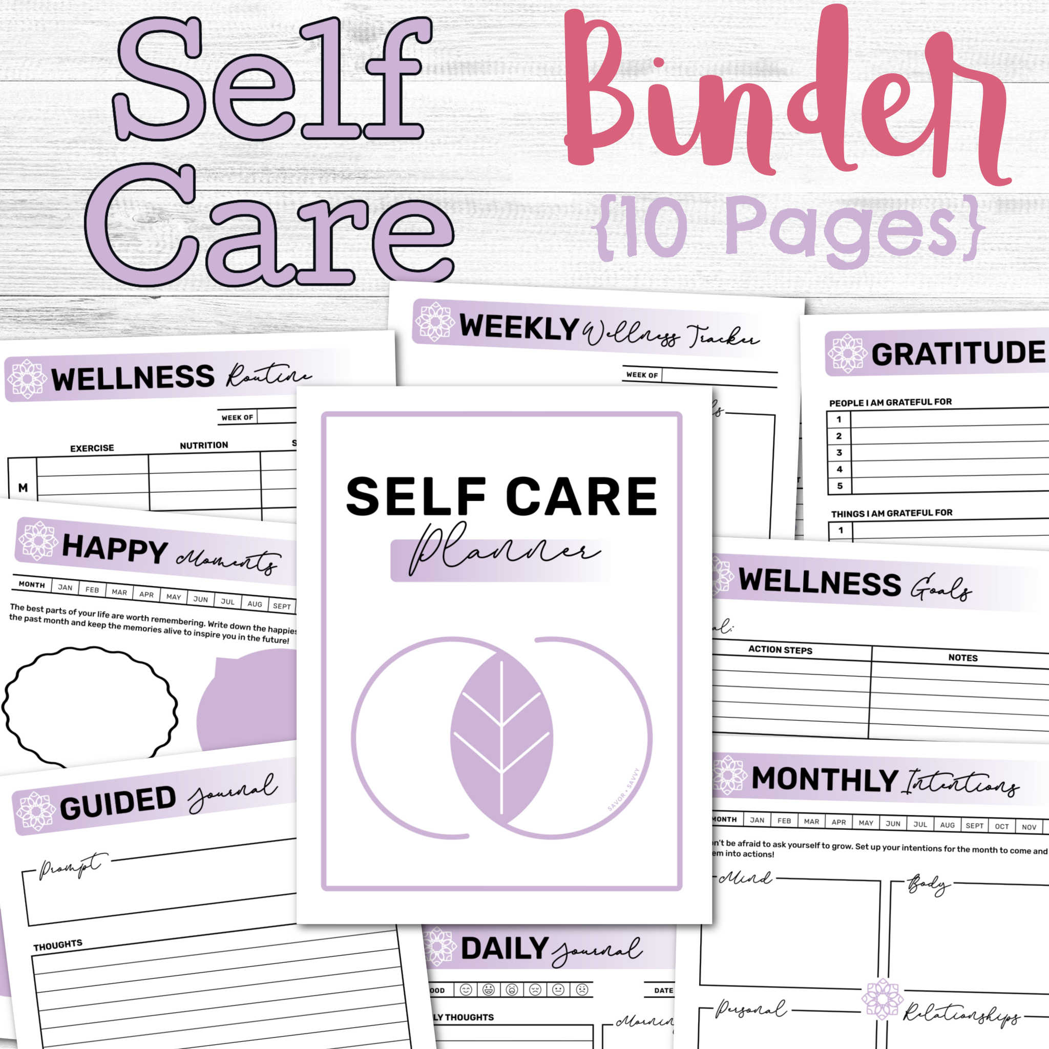self care binder on a white background with the pages scattered on the table.